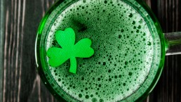 Happy St. Patrick's Day - green drink on wood desk